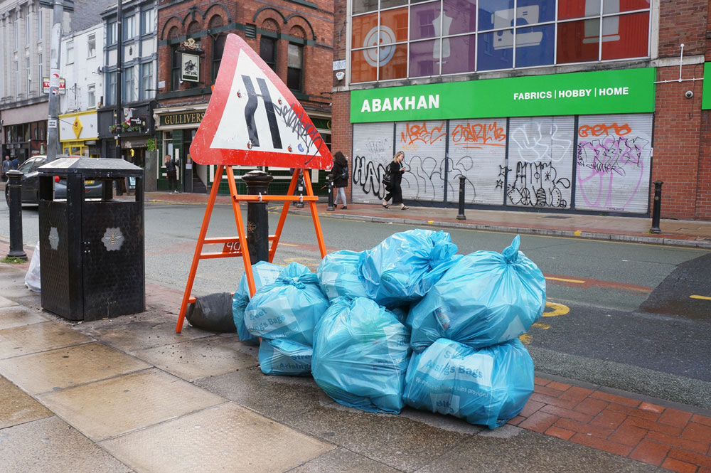 Waste Management is a real problem. A handful of bin bags in a centric neighbourhood. Northern Quarter. Published in The Green Bee. Author Juanele Villanueva