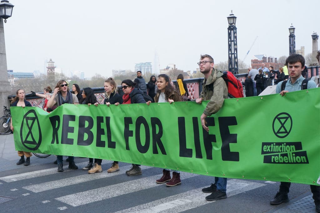 Extinction Rebellion XR goes on Rebellion. They occupied many places in Londoncut many roads in London. They have a banner with Rebel for Live. Published in The Green Bee: Eco-Journalism. Author Juanele Villanueva