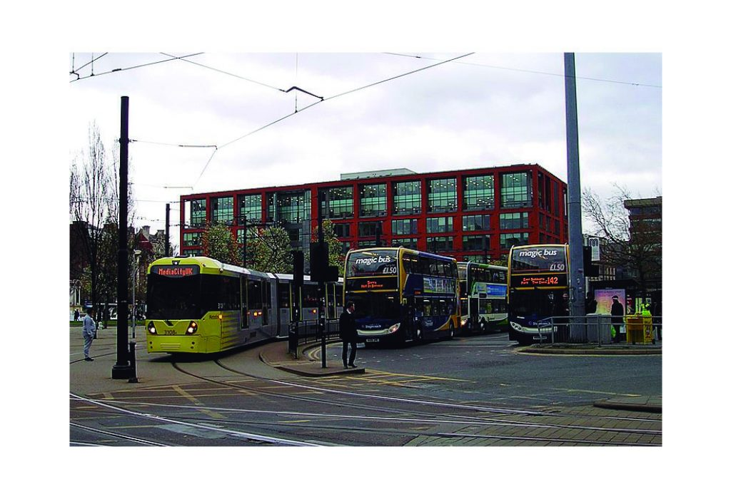 Electric coaches and buses. Piccadilly gardens in Manchester. It is a hotspot in public transport. several buses lines and trams joint there. Published at The Gren Bee: Eco-Journalism. Author Juanele Villanueva